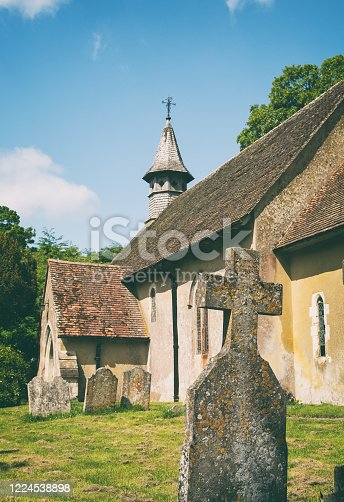 The graveyard at St Leonard's Church in the hamlet of Hartley Mauditt, Hampshire. Built in 1100 AD, it's a classic old Norman church surrounded by beautiful English countryside.