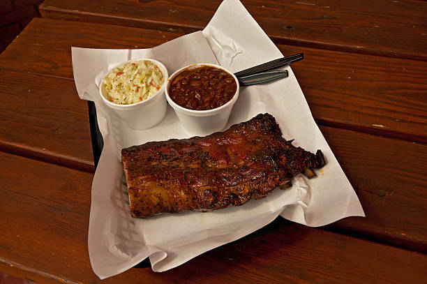 St Louis barbecue ribs with coleslaw and baked beans stock photo