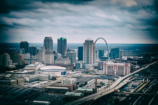Desaturated aerial image of the downtown skyline of St. Louis Missouri from about 700 feet in altitude.