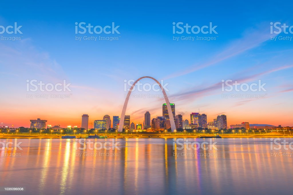 St. Louis, Missouri, USA Skyline St. Louis, Missouri, USA downtown cityscape with the arch and courthouse at dusk. Arch - Architectural Feature Stock Photo