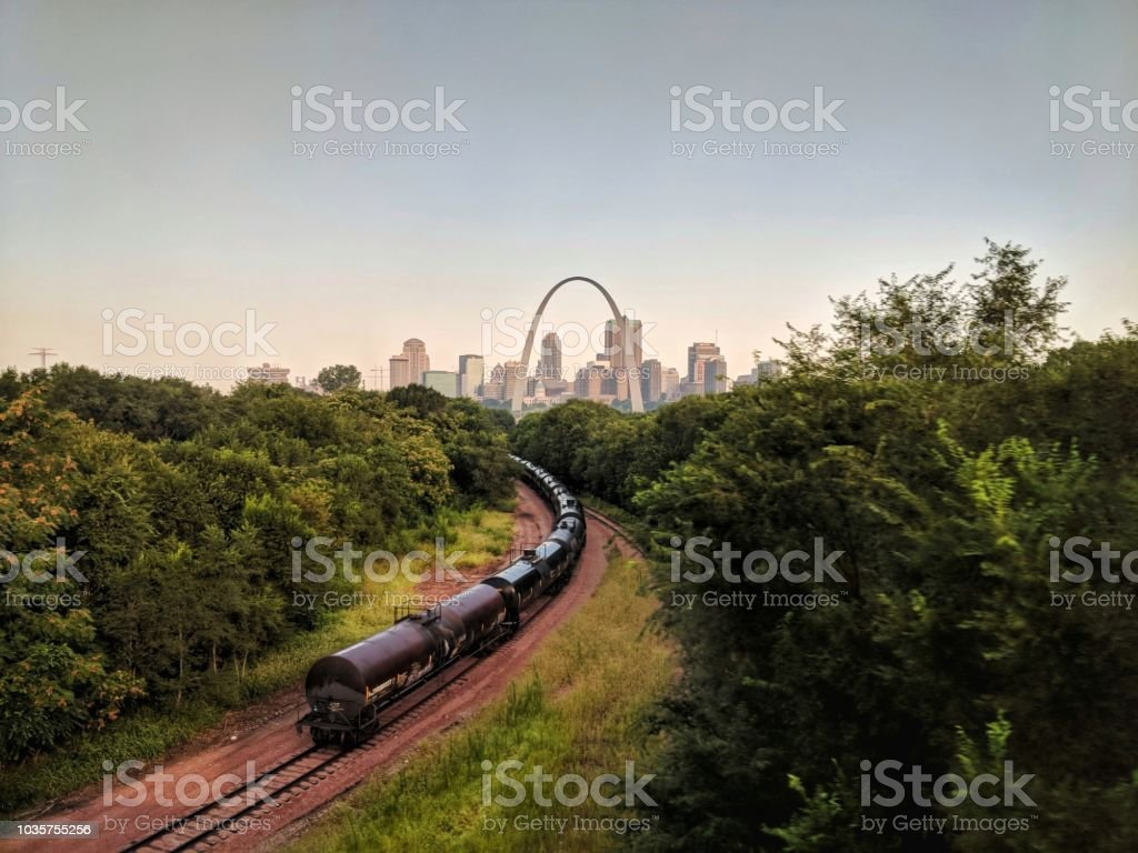 St Louis Skyline Snagged this picture on my way to Chicago by train. The logos have already been blurred, the rest is graffiti and numbers. Arch - Architectural Feature Stock Photo
