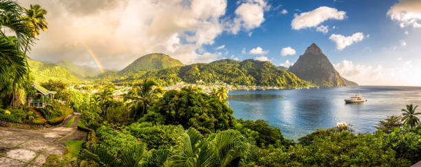 st. lucia - caribbean sea with pitons and rainbow - caribbean stock pictures, royalty-free photos & images