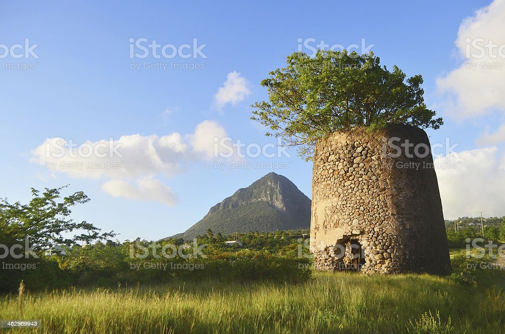 St Lucia: Soufriere scenic with old windmill and Piton stock photo