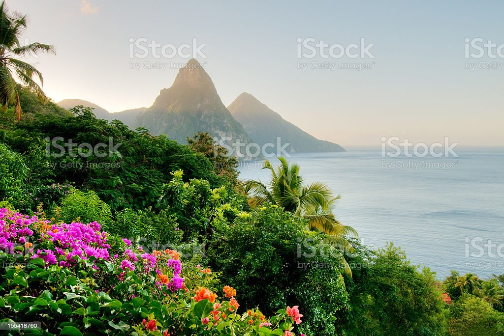 St. Lucia's Twin Pitons lit by sunrise glow stock photo