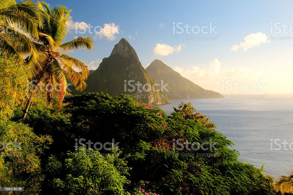 St. Lucia's Twin Pitons lit by sunset glow royalty-free stock photo