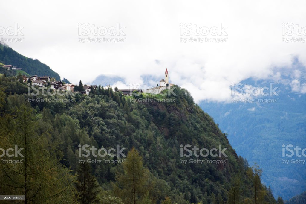 St. Martin Catholic Parish Church and umhausen and obergurgl village stock photo