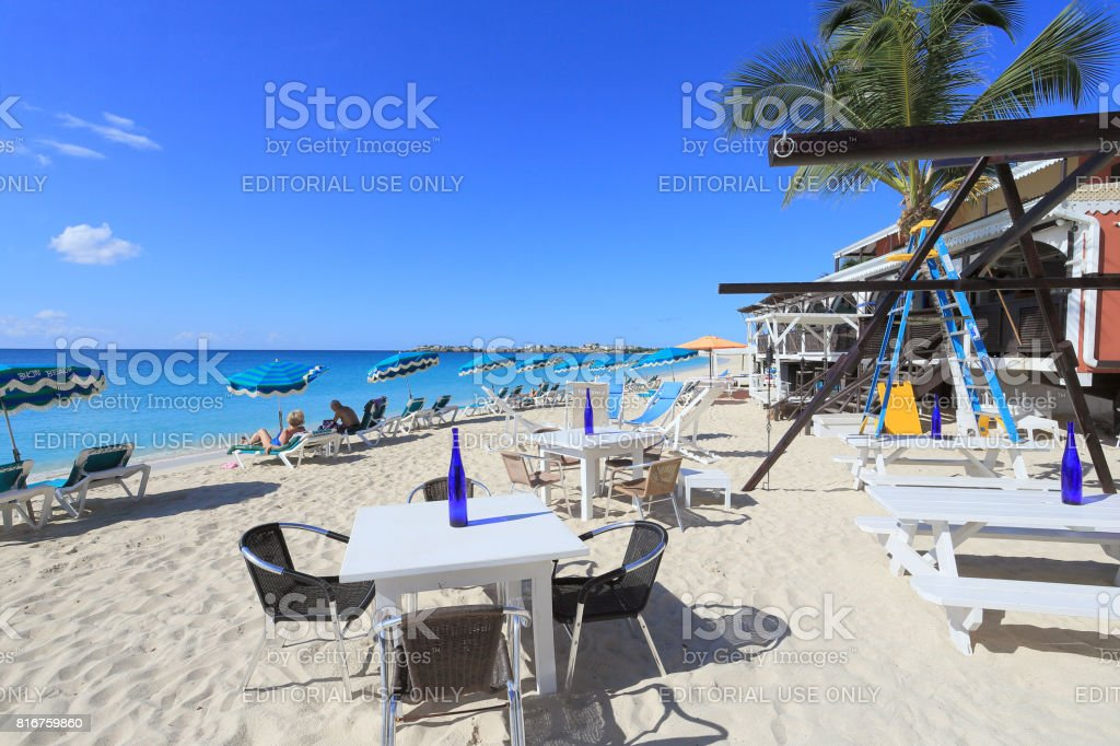 St Martin Island. Simpson beach and Palm trees stock photo