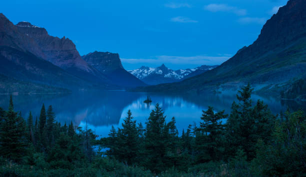 st mary lake at dusk - st. mary lake stock pictures, royalty-free photos & images
