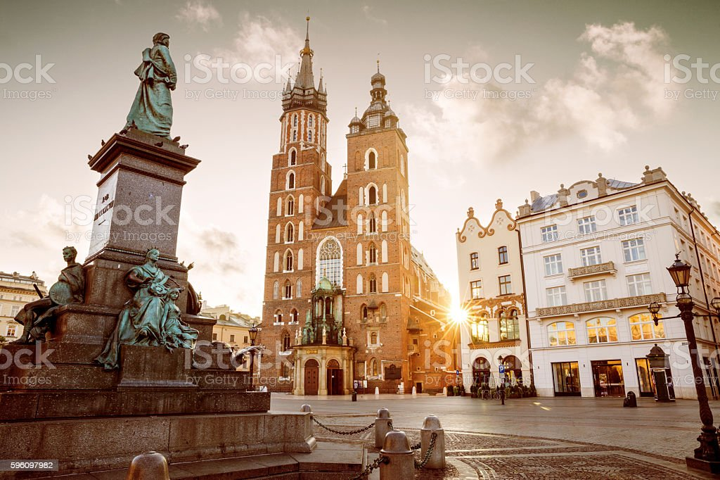 St. Mary's Basilica and Adam Mickiewicz monument on main square royalty-free stock photo
