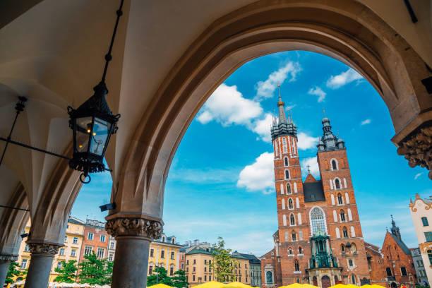 St. Mary's Basilica and Main Market Square (Rynek Glowny) in Krakow, Poland stock photo