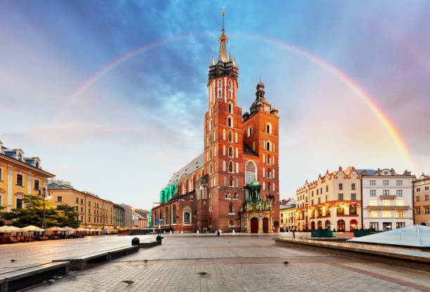 St. Mary's basilica in main square of Krakow with rainbow stock photo
