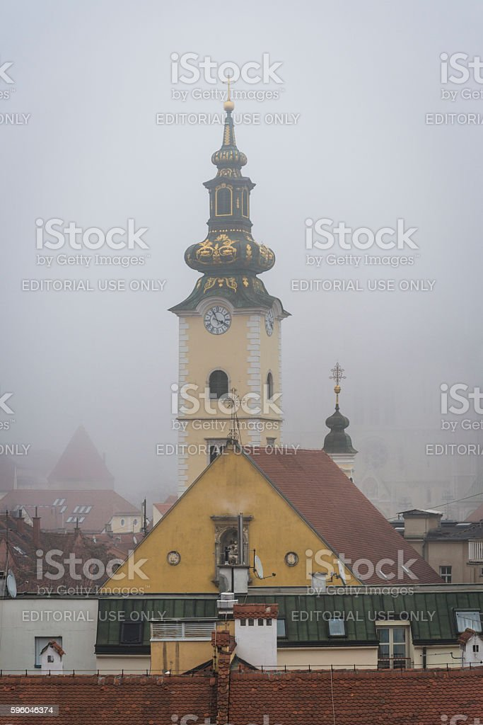 St Mary's Church Baroque tower in fog, Zagreb, Croatia royalty-free stock photo