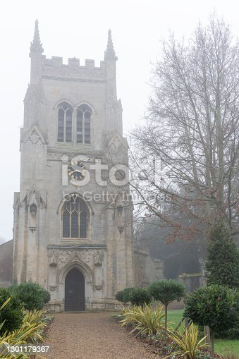 St Mary's Church Huntingdon, viewed through early morning mist in winter.