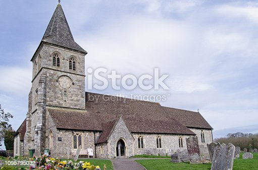 View in the Spring sunshine of the historic Anglican church of St Mary in the Hampshire town of Overton.