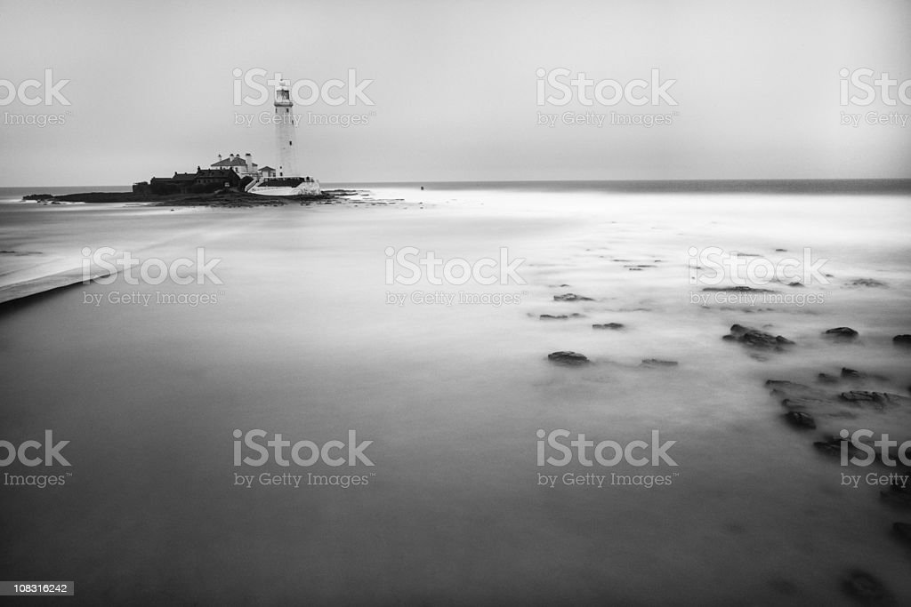 St Mary's Lighthouse black and white long exposure stock photo