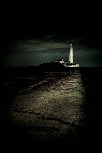 St. Mary's Lighthouse lightning up the night in Whitley Bay stock photo