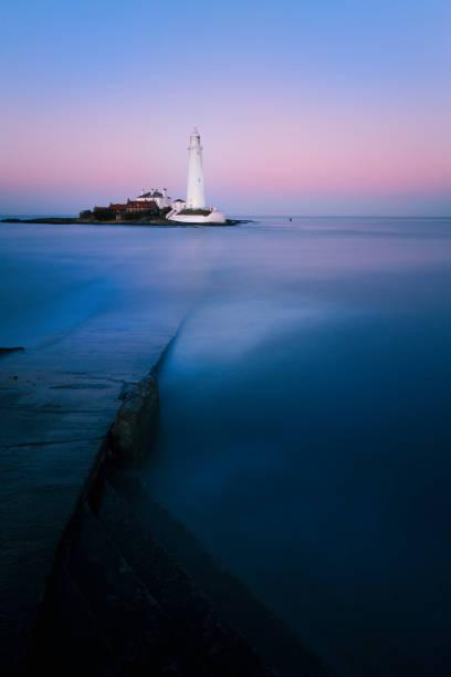 St Mary's Lighthouse sunset long exposure stock photo