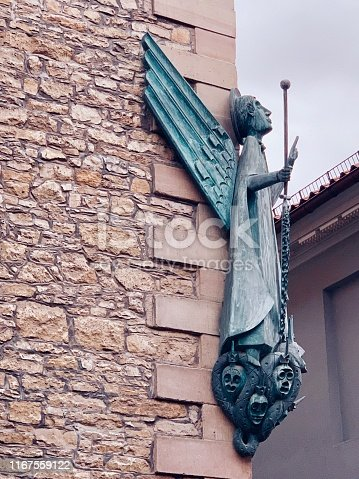 St. Michael church in Göttingen, Germany. Angel statue on the right side, front facade.