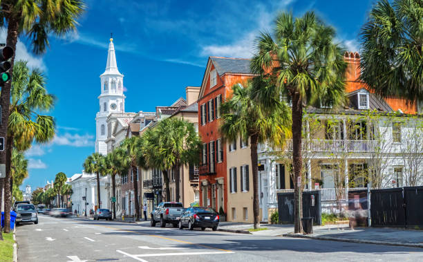 St. Michaels Church and Broad St. in Charleston, SC Scenic View of the St. Michaels Church from Broad St. in Charleston, SC southern usa stock pictures, royalty-free photos & images