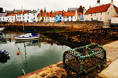 Harbourside of the fishing village of St Monans on the East Neuk of Fife, Scotland on a cloudy summer's day.
