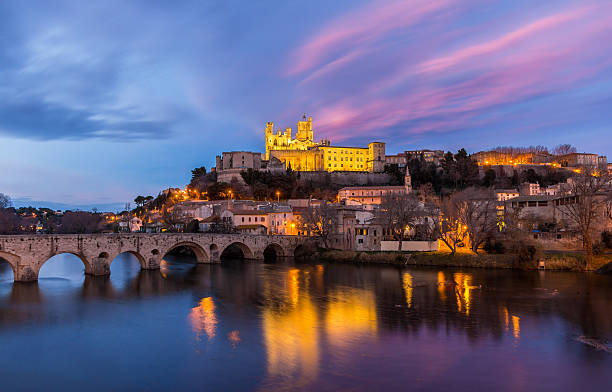St. Nazaire Cathedral and Pont Vieux in Beziers, France stock photo