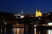 istock St. Nicholas Church, Strahov Monastery and bridge towers of Charles Bridge in Prague by night 1145674350