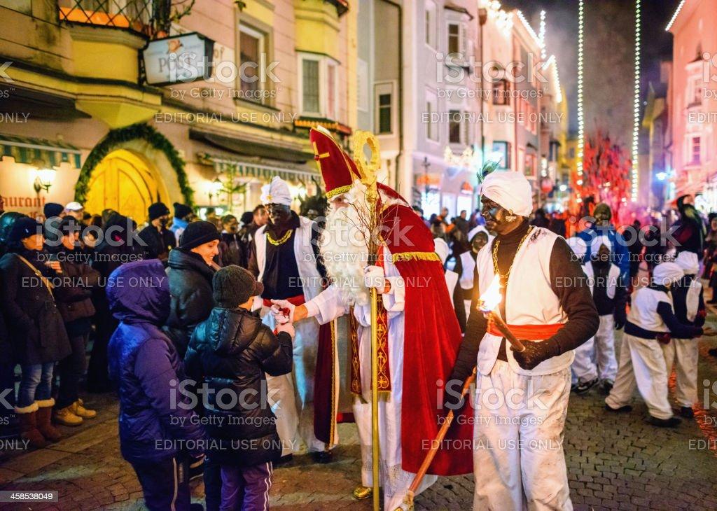 St. Nikolaus giving presents to children Sterzing/Vipiteno royalty-free stock photo