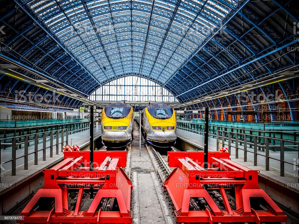 St Pancras red buffer stops with Eurostar trains stock photo