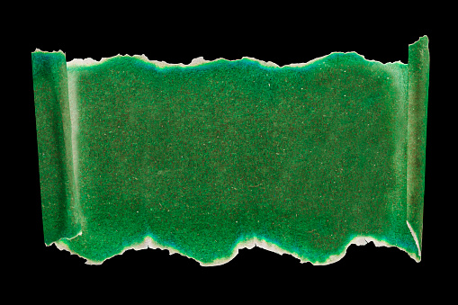 St Patrick day background on green scroll with faded edges on black isolate, mock up for sign or headline. Top view, copy space.