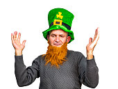 St. Patrick in a green top hat with clover. St.Patrick 's Day. Background image. Place for text. Male model.
