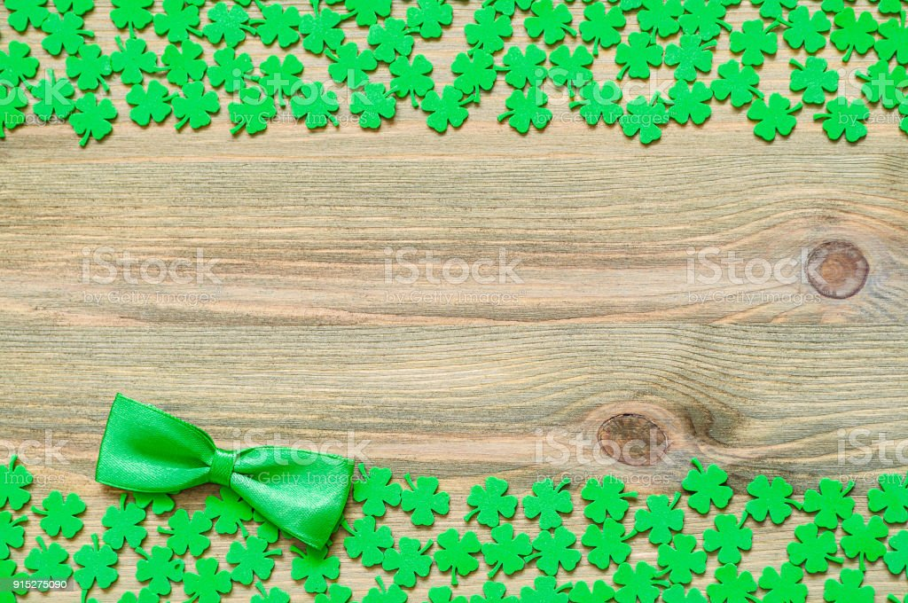 St Patricks Day background, border with quatrefoils and bow tie stock photo