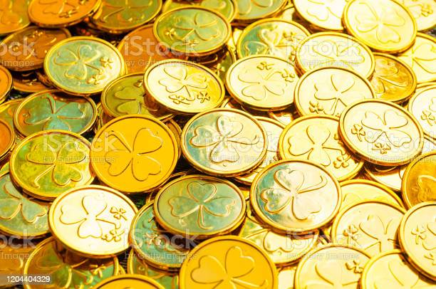 St patricks day background golden coins with shamrock under soft st picture id1204404329?b=1&k=6&m=1204404329&s=612x612&h=0jtlbkuys4dii3c0eo1wqt it7xvxpmurytthkjyhzy=
