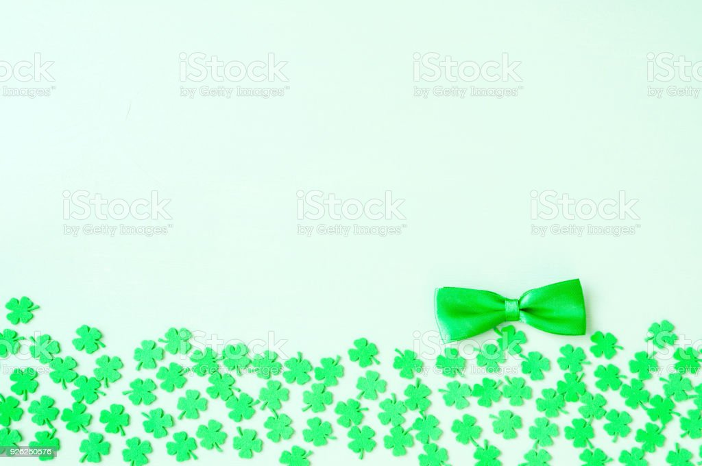 St Patricks Day background - green quatrefoils and bow tie stock photo