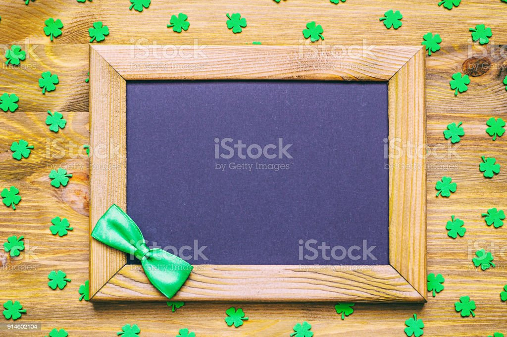 St Patricks Day background with green quatrefoils and bow tie stock photo