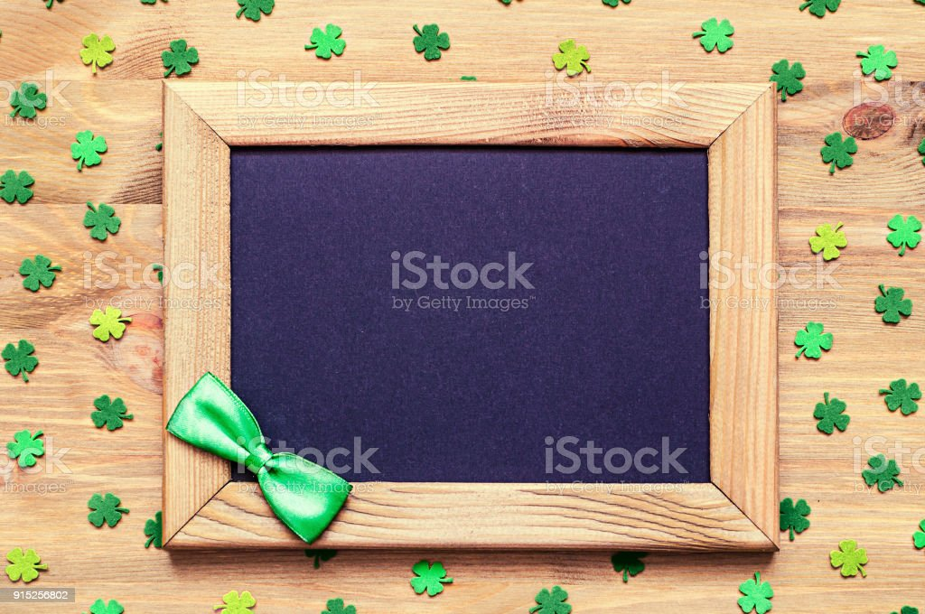 St Patricks Day background with green quatrefoils and wooden frame stock photo