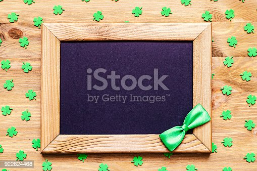 istock St Patricks Day background with quatrefoils and wooden frame 922624468
