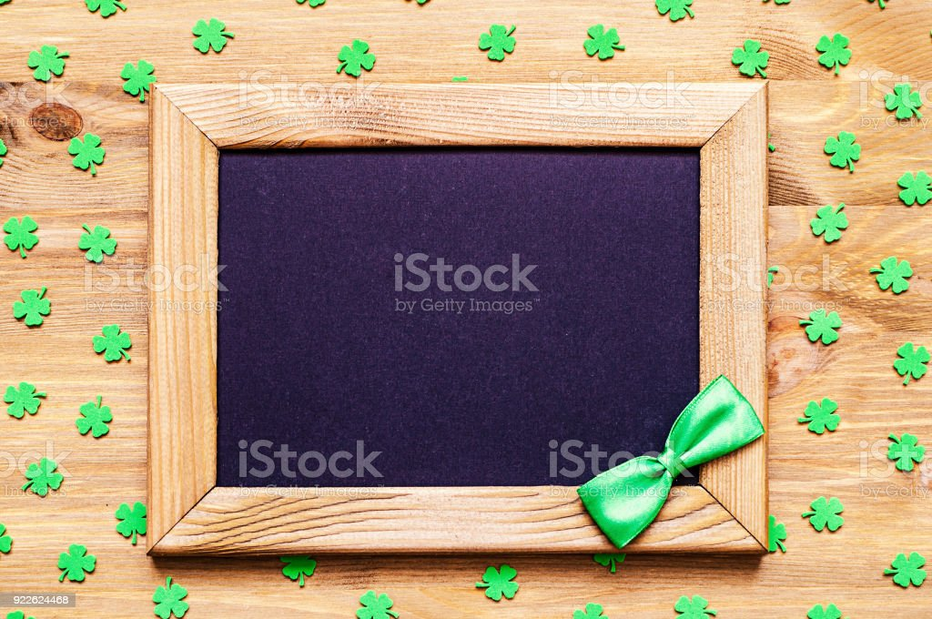 St Patricks Day background with quatrefoils and wooden frame stock photo
