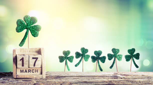 st. patrick's day - calendar date and clovers - st patricks day stock photos and pictures