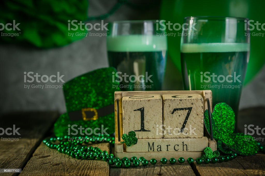 St. Patricks day concept - green beer and symbols stock photo