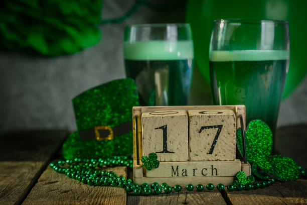 st. patricks day concept - green beer and symbols - st patricks day stock photos and pictures