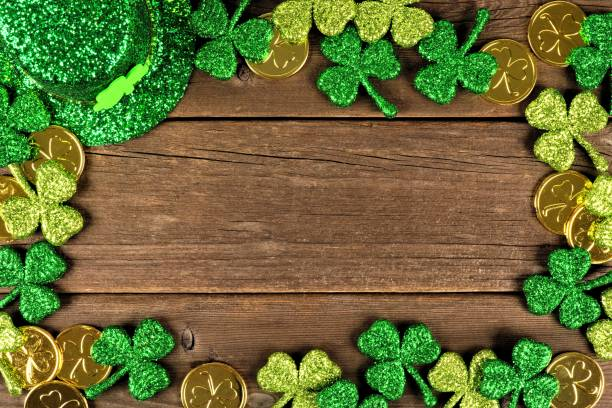 st patricks day decor frame over rustic wood - st patricks day stock photos and pictures
