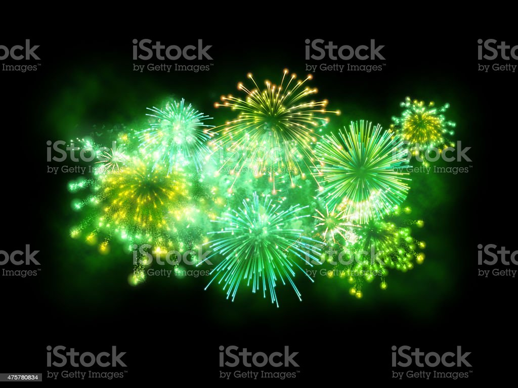 St. Patrick's Day green fireworks show isolated on black background stock photo