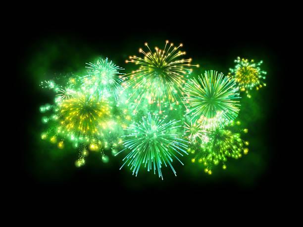 st. patrick's day green pokaz sztucznych ogni wyizolowane na czarnym tle - new year zdjęcia i obrazy z banku zdjęć