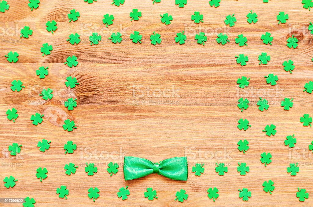 St Patrick's Day holiday background, green quatrefoils and bow tie stock photo
