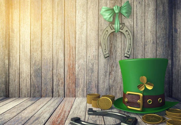 st. patrick's day leprechaun hat with gold coins and horseshoes - st patricks day background stock photos and pictures