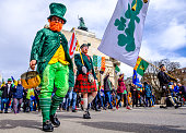 Munich, Germany - March 11, 2018: People celebrating the annual national irish holiday St. Patricks day marching in the old town in munich, germany on  March 11, 2018