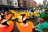 Dublin, Ireland - March 17, 2011:Children in their colorful costumes, participating  Dublin St Patrick's day parade with spectators in mostly Irish colors.