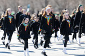 Chicago, Illinois, USA - March 16, 2019: St. Patrick's Day Parade, The Trinity Irish Dancers, dancing at the parade, going down Columbus Dr.
