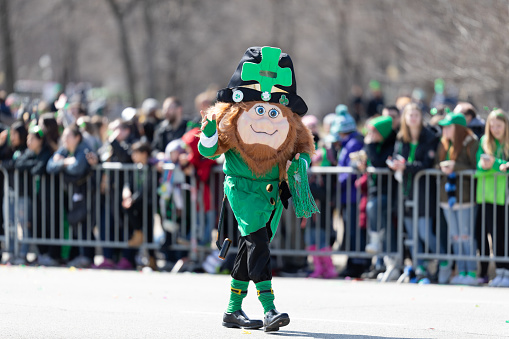 Chicago, Illinois, USA - March 16, 2019: St. Patrick's Day Parade, Person wearing a Lepruchan costume, waving, walking down Columbus Drive