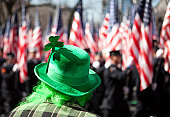 St. Patrick's Day parade in Manhattan, New York City. Extremely shallow depth of field, focus on the three leafed clover. Defocused American flags in the background. Location: New York City along 5th Avenue. Year: 2009
